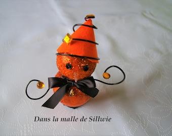 orange and black Christmas snowman decoration has glitter
