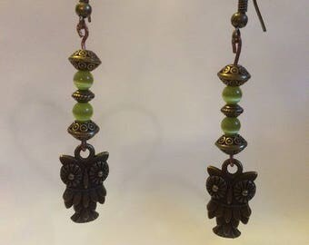 Bronze earrings with owls and green beads