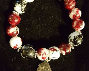 Black, Red, and White beaded stretch bracelet