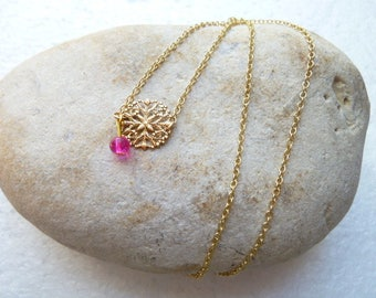 Necklace with gold charm and Pink Pearl