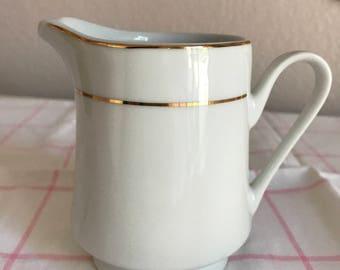 Elegant white and gold cream pitcher, vintage pitcher
