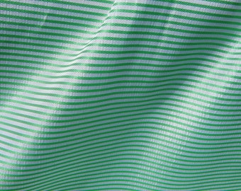 1 m green and white striped synthetic fabric