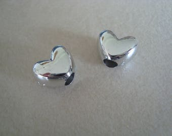 Set of two beads silver color heart shape