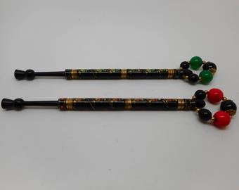 A pair of painted and wired vintage lace bobbins. ( no. 7 )