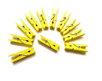 set of 11 35mm yellow clothespins