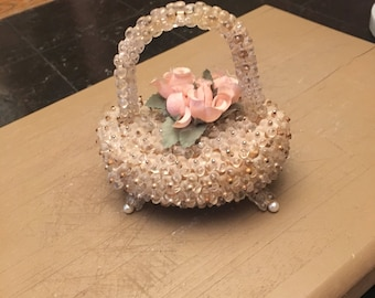 Vintage glass and pin flowers basket .