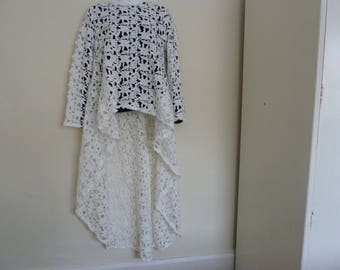Beautiful white crochet/lace/applique hi-lo top.  Size 10