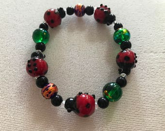 Purple/Gold/Green Ladybug Bracelet