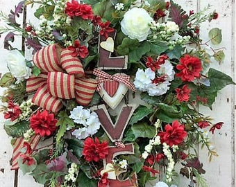 "You will ""Love"" this Valentine's Day  Wreath with Red Zinnia, Coreopsis, White Geranium, Ranunculus, Cream and Green Berries and Love Plaque"