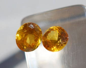 Lot of 2 Ceylon Sapphire - Faceted   of natural color, yellow, clean, corundum, round, 5 mm, 1.2 TCW, F1945