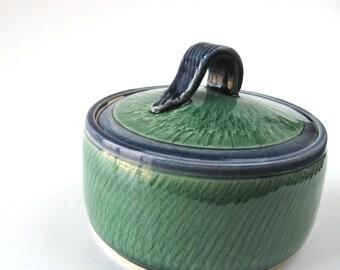 Blue and green lidded jar, Lidded green cannister, Blue jar