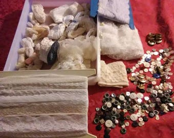 Vintage buttons and lace. Comes with the container with lid.