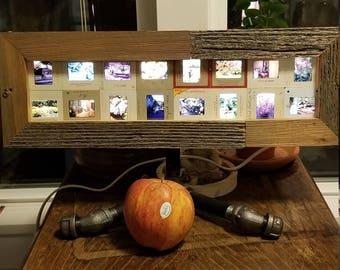 Art piece, light, pictures. People and gardens. Table lamp made of slides and reclaimed wood