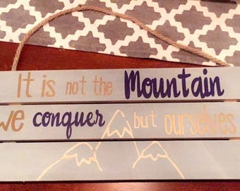 It is not the mountain we conquer but ourselves sign
