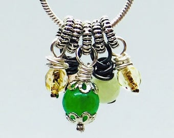 Wire wrapped charm necklace. Sterling silver snake chain