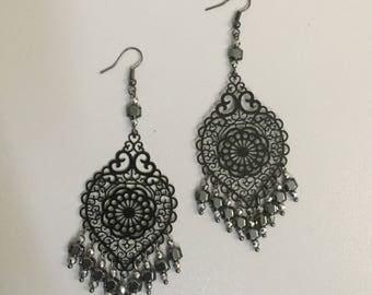 Earrings with filigree and semiprecious hematite stones