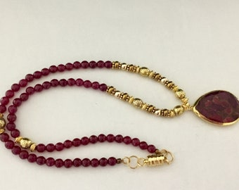 Red garnet and golden beads necklace