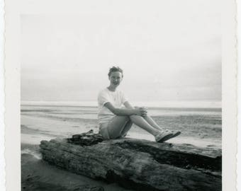 vintage photo 1950s Young Woman Sits on Square Snapshot