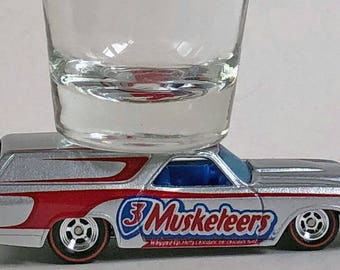 the Original Hot Shot shot glass, '70 Chevy Chevelle Panel Truck, 3 Musketeers,  Hot Wheel car