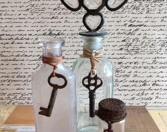 Antique Glass Bottles With Skeleton keys