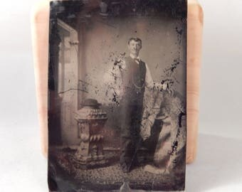 Tintype of Man Standing with Hat on Pillar