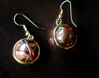 Modernist vintage 90s, copper , ball shape with a fishhook, dangle , hand made earrings, featuring world globe.