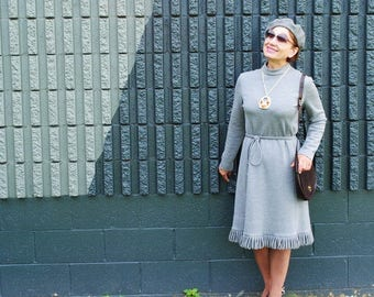 Classy vintage 70s,  gray,  heavy polyester dress with a looped fringe,  tie-belt. Made by  Gregg Draddy.  Size M.
