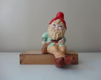 VINTAGE ceramic sitting garden GNOME FIGURINE