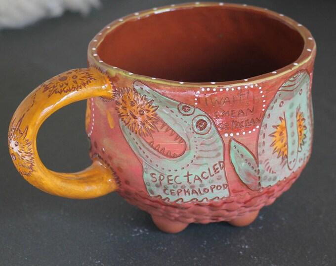 Dolphin and Pufferfish mug