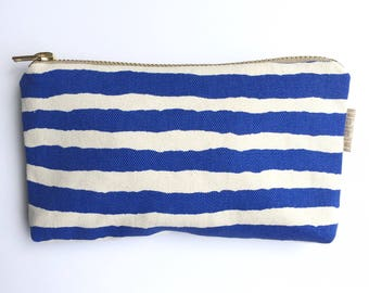 Torn paper blue stripe purse pouch makeup bag