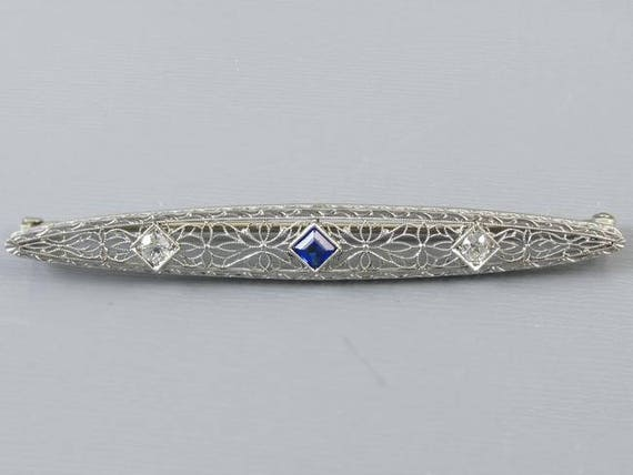 Antique Art Deco 14k white gold and platinum European cut .32 carat diamond and blue sapphire filigree bar pin brooch signed Krementz