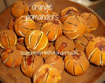 Whole dried Orange Pomanders partially dipped in Certified Organic Beeswax and heavily scented pure Sweet Orange and Clove Essential Spiced