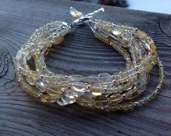 Fantastic Seven Strand Soft and Faceted Citrine Gemstone and Birthstone Bracelet Including Toggle with Citrine Dangle
