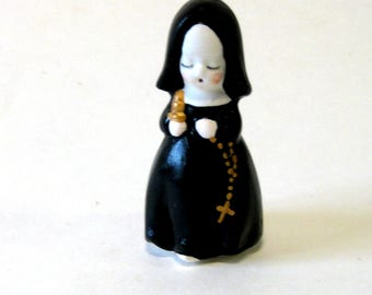 Handcrafted nun in porcelain three inches tall