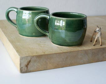 Two stoneware pottery round mugs - glazed in forest green
