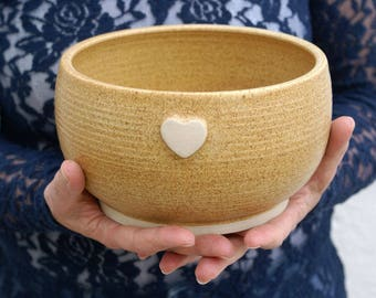 Handmade stoneware bowl - wheel thrown bowl in natural brown with heart motif