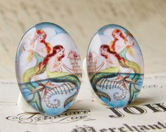 Mirrored pair of mermaids riding on a seahorse, two handmade glass oval cabochons, opposites for earrings, 25x18mm 18x25mm, art cabochon