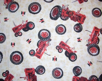 International Harvester Tractors on Cream(offwhite) -Cotton Fabric- 43 inches wide and sold by the yard