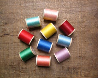 10 Wooden Spools of Colorful Thread