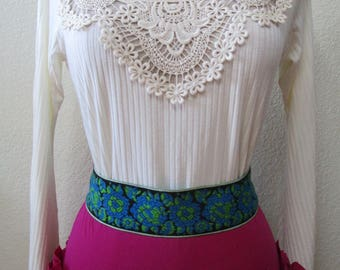 Cream color long bell sleeves top with crochet floral decoration in front center plus made in USA (vn72)