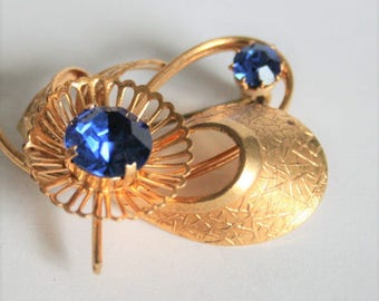 Vintage blue crystal brooch.  Flower brooch. Vintage jewellery