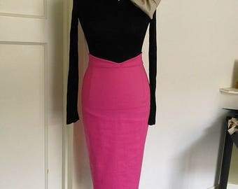Hot Pink, tailored, midi, pencil skirt with high nipped in waistband. Available in sizes XS-XL or made to measure.