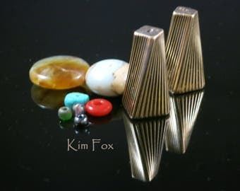 Large Art Deco Cones designed with a twist in bronze by Kim Fox
