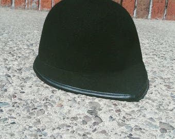 The bobby hat in black with leather trim