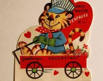1950s TIGER in an engineer uniform, sitting in a wagon valentine, unused, anthropomorphic tiger valentine