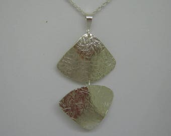 textured sterling silver pendant