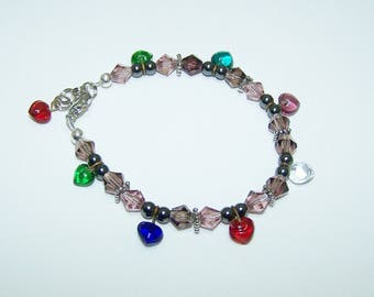 Child's charm bracelet with hearts and crystal cut glass bicones