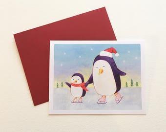 Skating Penguins Christmas Card by Megumi Lemons