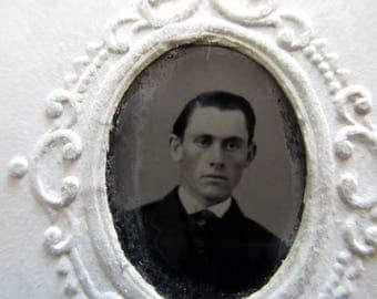 antique tintype with paper frame - young man