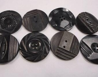 Vintage buttons - 8 medium black coat buttons, moulded designs, Art Deco etc